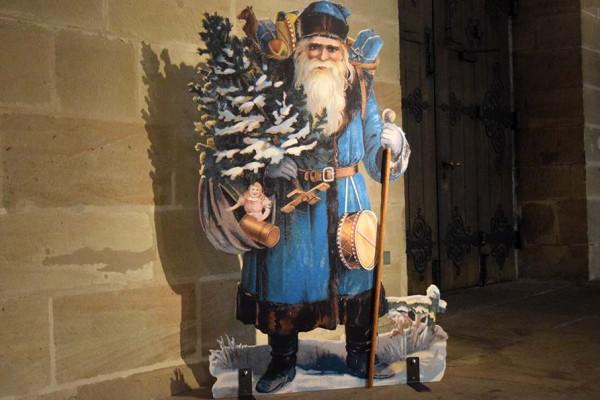 Weihnachtsmann mit blauem Mantel (Oblatenbild), Dänemark um 1900.